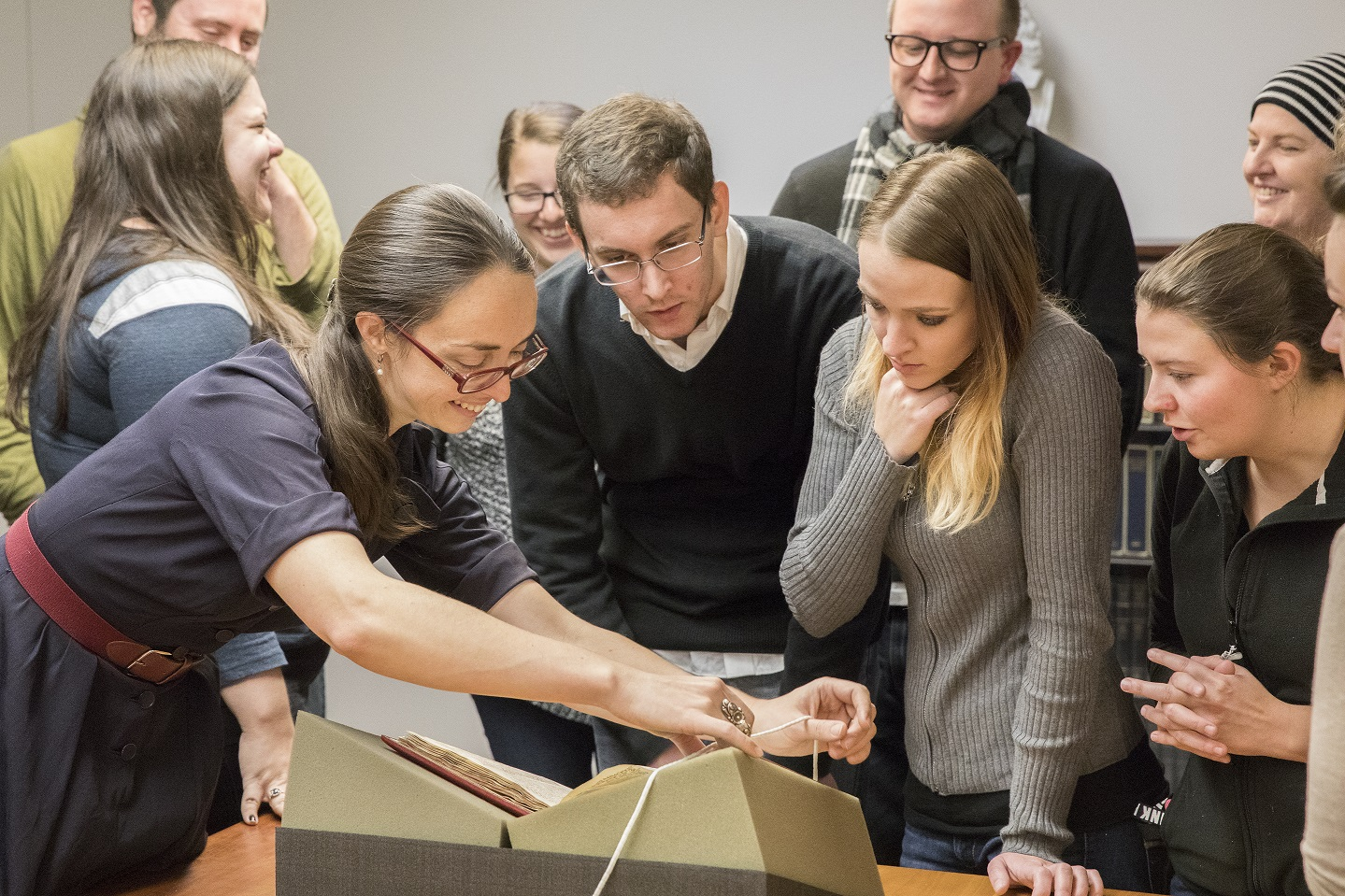Professor Kayla Whearty and her students examine new acquisition, Postilla litteralis super epistolam ad hebraeos.