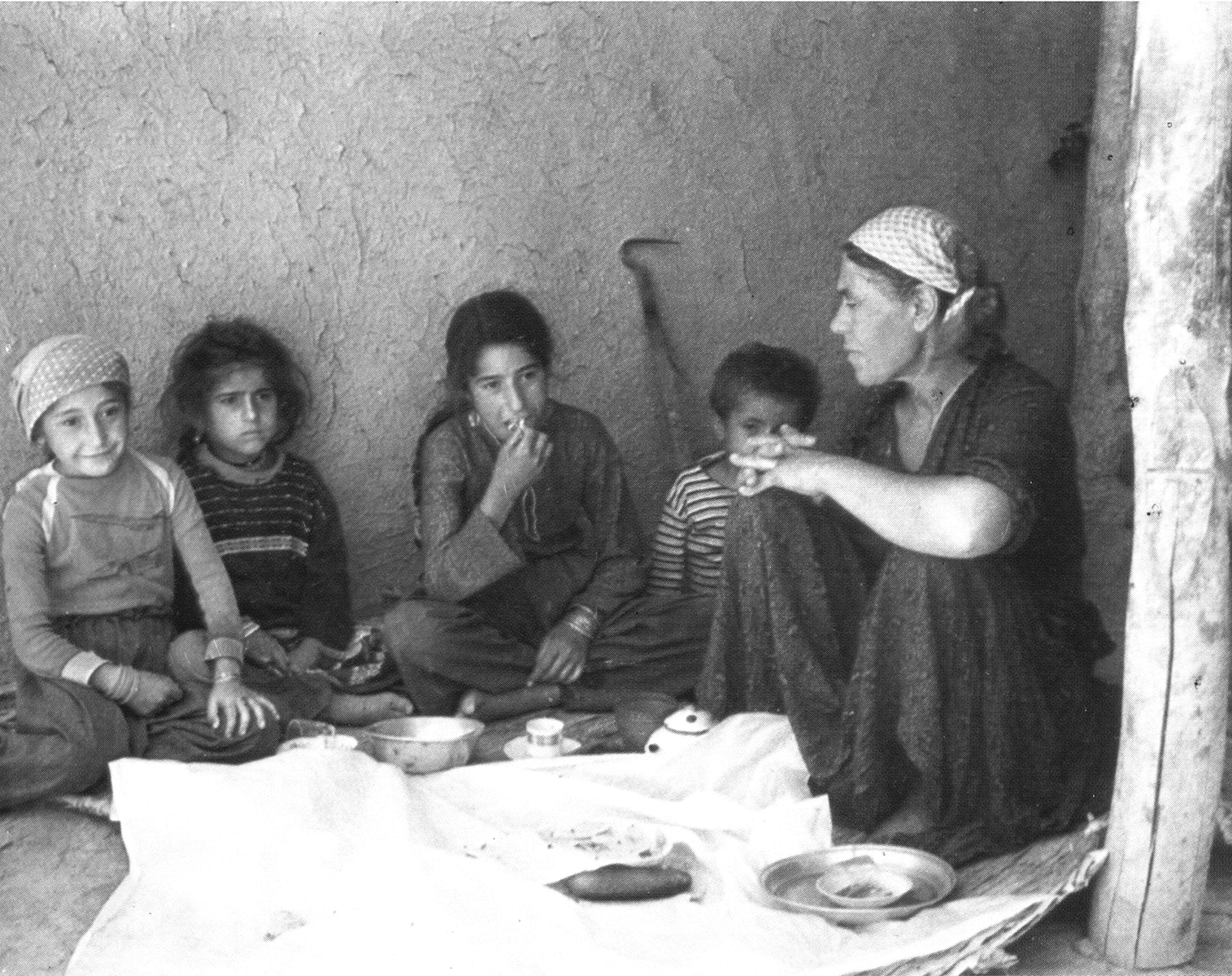 Kurdish children and woman sitting small