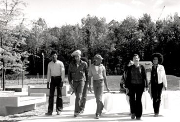 African American Students walk together near College-in-the-Woods on Binghamton University campus in 1971