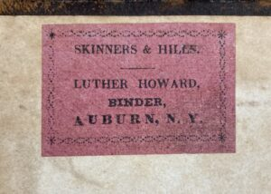 Skinners & Hiles | Luther Howard binder's ticket on front pastedown