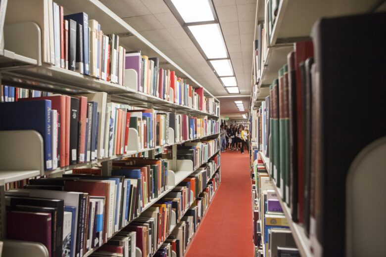 Crowded shelves of books in Bartle's Fine Arts Collection