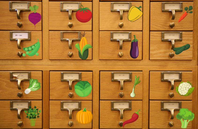 Card catalog with vegetable stickers near the drawer pulls.