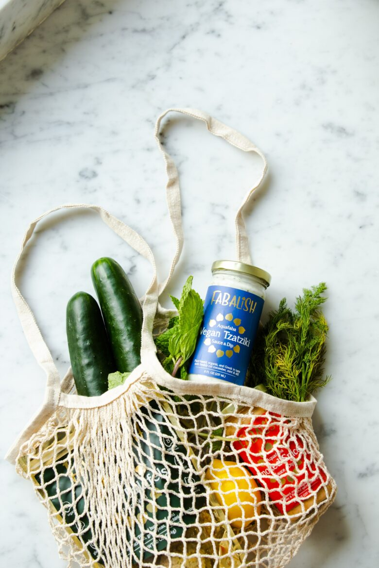 Mesh cloth bag with vegetables.