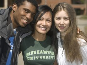 Three Binghamton students with arms around each other