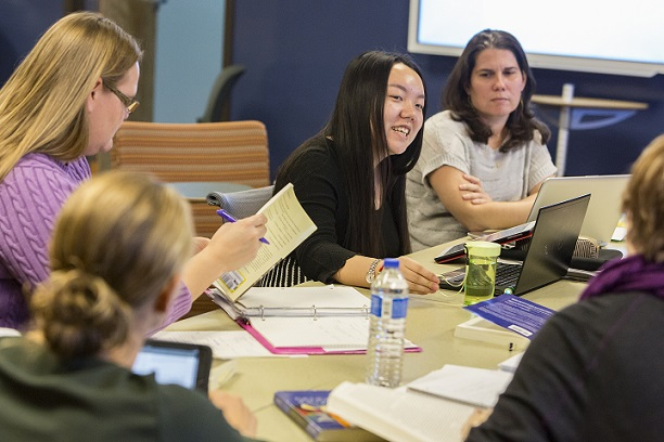 faculty engages in a research discussion